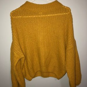 Yellow Cropped Blouse with Baggy Sleeves.